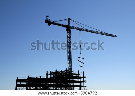 Silhouette of a Construction Site - stock photo