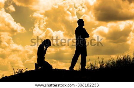 Silhouette of a crying woman and man angry - stock photo