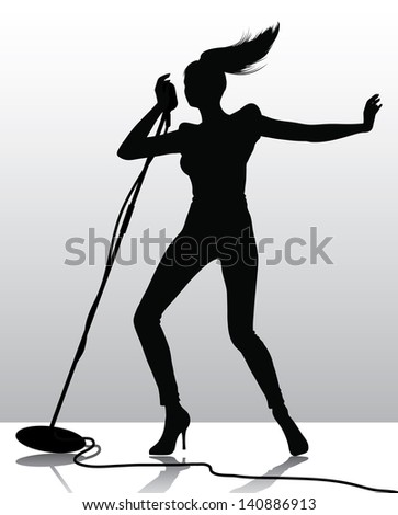 silhouette of a female singer with the microphone stand (also available vector version) - stock photo