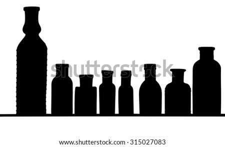 Silhouette of a few bottles - stock photo