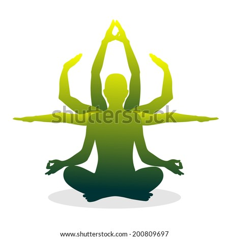 silhouette of a figure in lotus position - stock photo