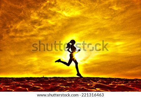 Silhouette of a girl running on the background of clouds the effect of film - stock photo