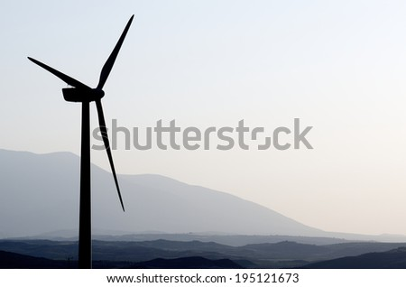 silhouette of a group of windmills for renewable electric energy production, Fuendejalon, Zaragoza, Aragon, Spain - stock photo