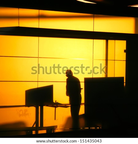 Silhouette of a guardians in a travel inspection point. - stock photo