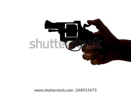 Silhouette of a  hand with a handgun - stock photo