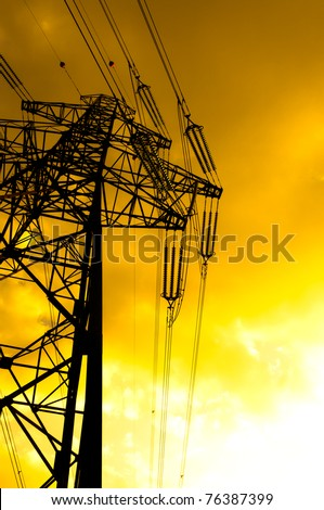 Silhouette of a high voltage post - stock photo