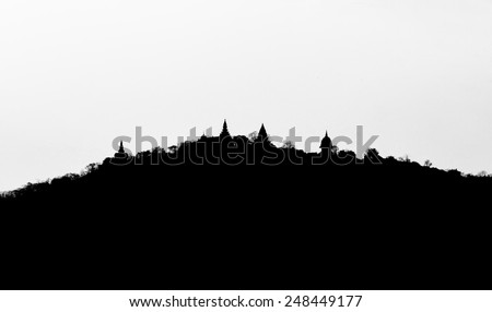 Silhouette of a hill with monastery on top of it, in Thailand - stock photo