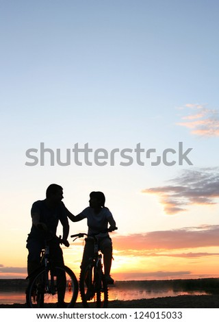 silhouette of a loving couple  Space for inscription - stock photo