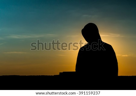 Silhouette of a Man at Dawn - stock photo