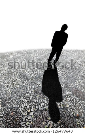 Silhouette of a man casting a long shadow on a cobble stone road against a white background with blank space for text. - stock photo