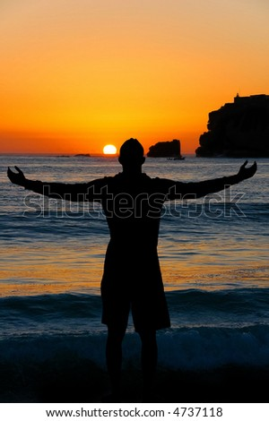 Silhouette of a man over Sunset - stock photo