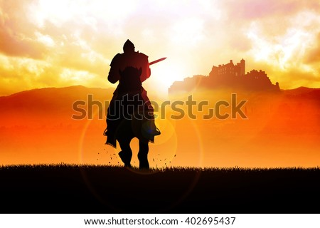 Silhouette of a medieval knight on horse carrying a lance on dramatic scene - stock photo