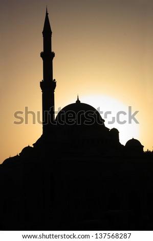 Silhouette of a mosque in Dubai - stock photo