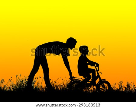 silhouette of a mother who teaches his son to ride a bike. - stock photo