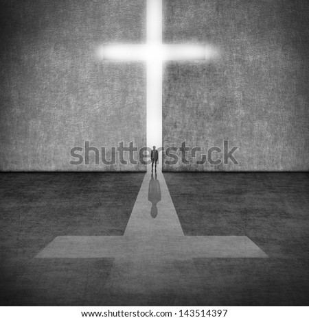 Silhouette of a person before a symbol of faith - stock photo