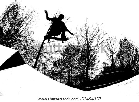 silhouette of a skateboarder at the local skate park. - stock photo