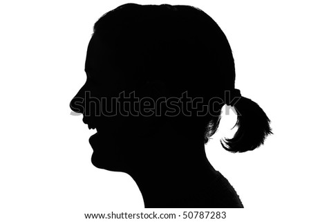 silhouette of a smiling girls profile isolated on white - stock photo
