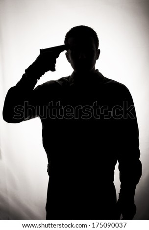 Silhouette of a suicidal man  - stock photo