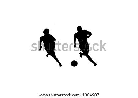 Silhouette of a two male soccer players vying for the ball - stock photo