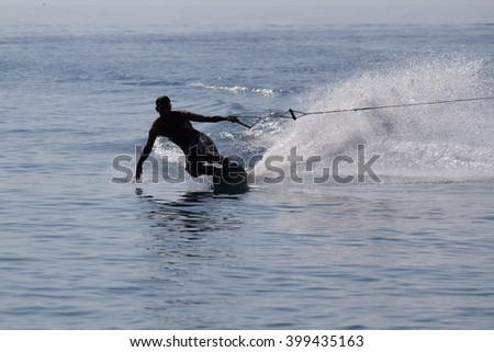 Silhouette of a water skier - stock photo