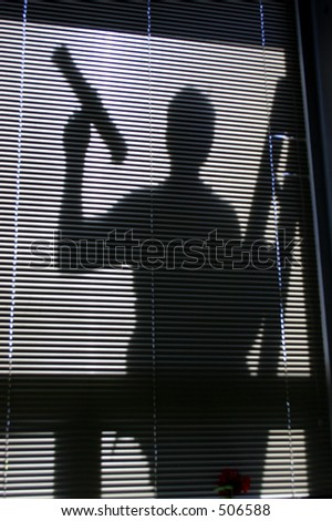 Silhouette of a window washer - stock photo