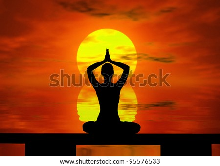 Silhouette of a  woman doing yoga at the sunset - stock photo
