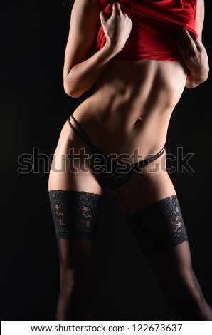 silhouette of a woman in the dark - stock photo