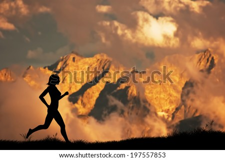 Silhouette of a woman running, jogging in the mountains scenery at sunset. Active, healthy lifestyle - stock photo