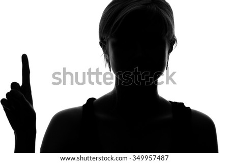 silhouette of a woman showing one finger - stock photo