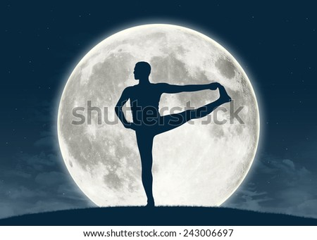 silhouette of a young man practicing yoga with the full moon on the background, elements of this image furnished by NASA - stock photo