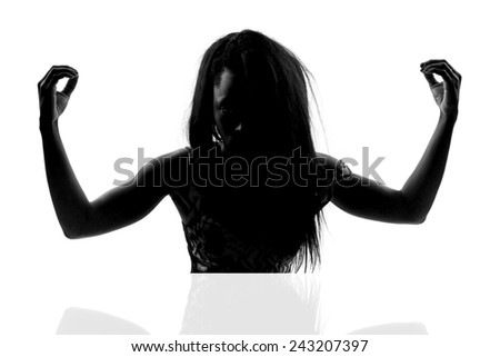 silhouette of a young woman - stock photo