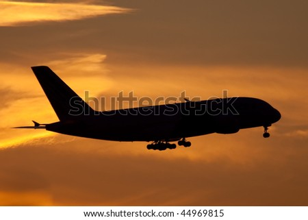 silhouette of airliner - stock photo
