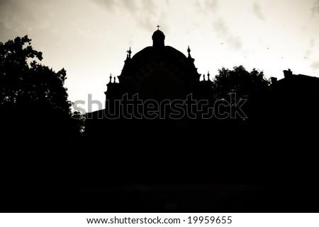 silhouette of an abandoned church in croatia - stock photo