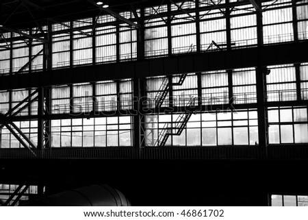 Silhouette of an industrial facility. View of the ladder - stock photo