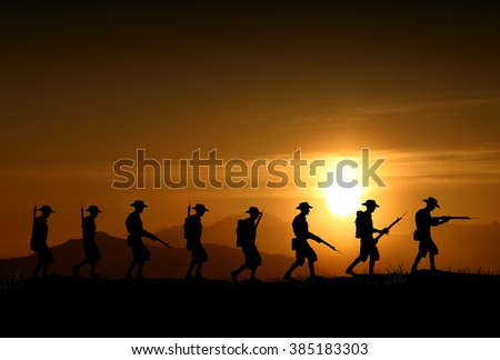 Silhouette of Australian ANZAC soldiers against the sky.(Artist drawn silhouette on photo background) - stock photo