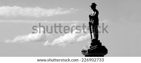 Silhouette of Australian soldier sculpture from WW2 in ANZAC Square in Broadwater Parklands Gold Coast Queensland Australia. - stock photo
