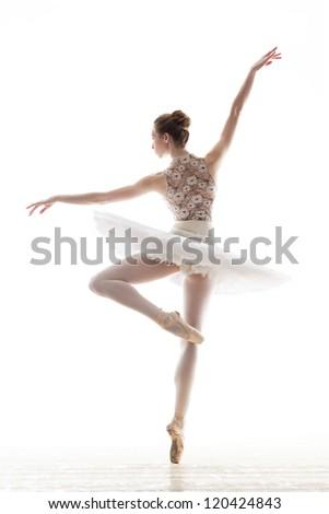 silhouette of ballerina in classical tutu in the white studio - stock photo
