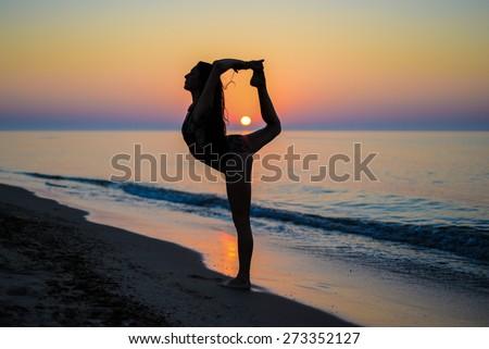 silhouette of beautiful girl on the beach - stock photo