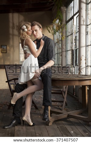 Silhouette of beauty young adult couple in love posing in classic elegance dress to date - stock photo
