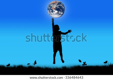 silhouette of boy happy jumping touch the earth , night background,the backdrop of the planet earth. Elements of this image furnished by NASA. - stock photo