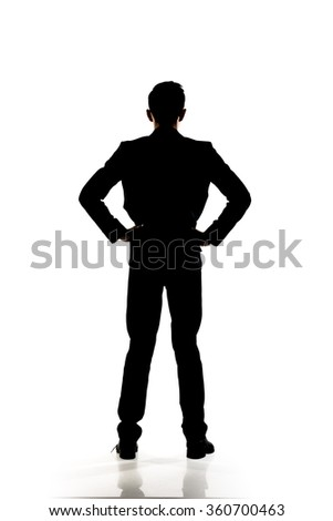 Silhouette of business man standing, full length portrait isolated. - stock photo