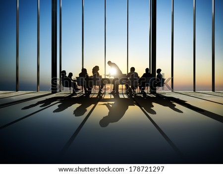 Silhouette of Business Meeting at Sunset - stock photo