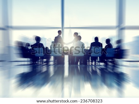 Silhouette of Business Person in a Board Room - stock photo