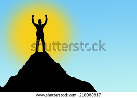 Silhouette of businessman hold up hands on the peak of mountain,success concept - stock photo