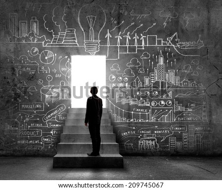 Silhouette of businessman standing in doorway light - stock photo