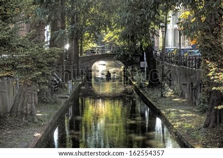 Silhouette of canoe on the Oudegracht in Utrecht - stock photo