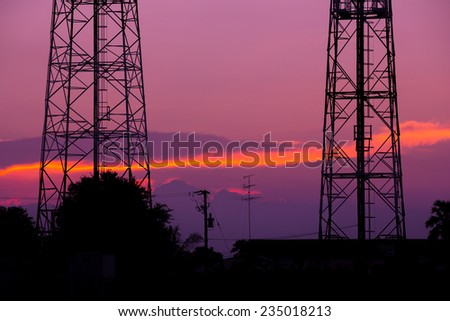 Silhouette of communication tower in a wonderful sunrise - stock photo