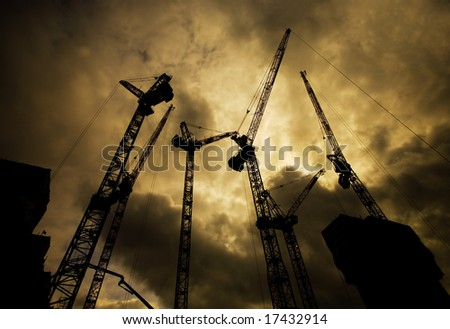 Silhouette of construction cranes - stock photo