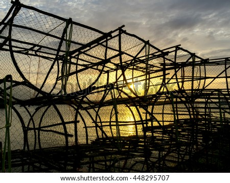 Silhouette of crab traps in the morning. - stock photo