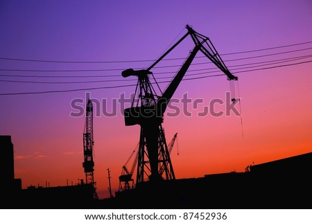 Silhouette of crane at the harbor of Malta, Europe, during sunrise - stock photo